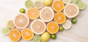 Citrus bunched together on a wood background